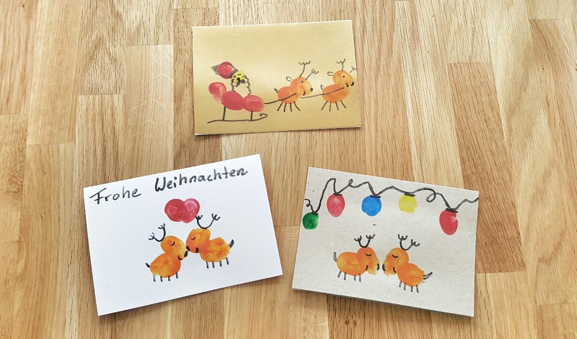 Weihnachtskarten mit Fingerabdrücken Elche und Rentiere